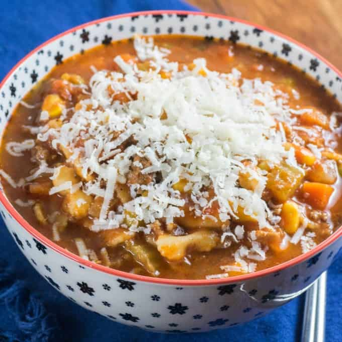 Bowl of Easy Peasy Hamburger Minestrone Soup topped with Parmesan cheese