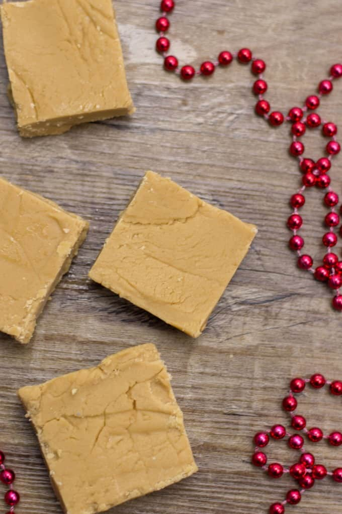 Easy Peanut Butter Fudge in squares on a board