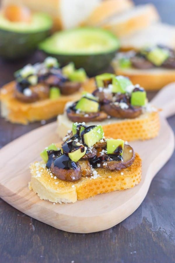 Mushroom, avocado and feta toasts on a serving platter