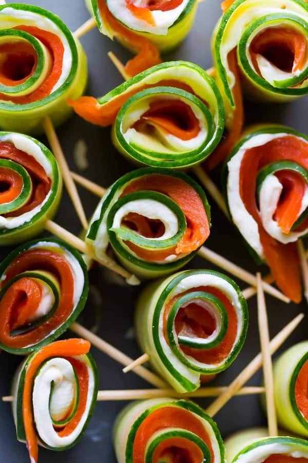 Smoked salmon cucumber roll-ups on a tray