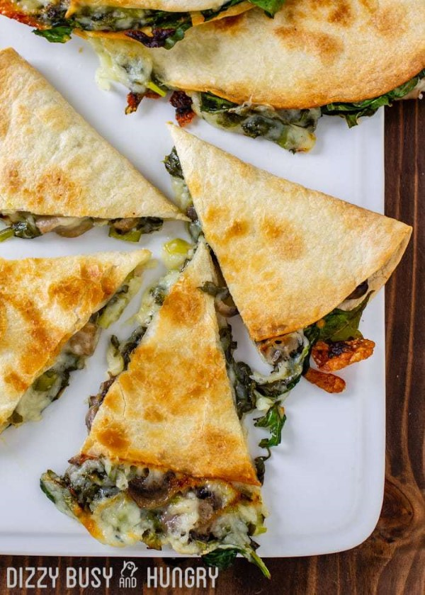 Baked Spinach Mushroom Quesadillas on a white platter