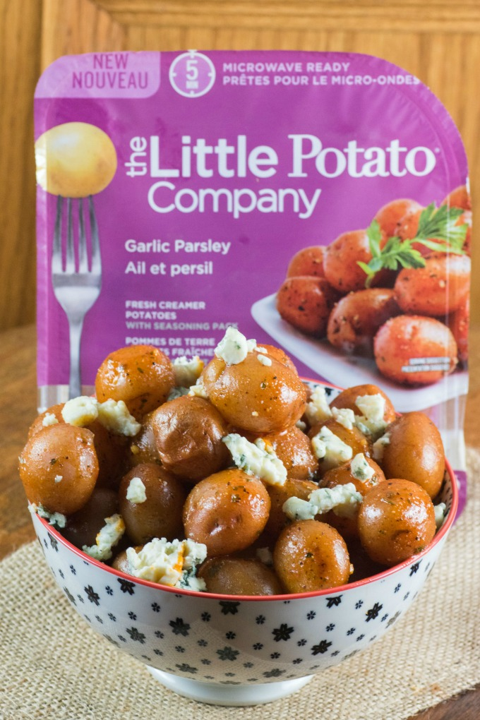 Buffalo Wing Potatoes in a bowl with The Little Potato Company's Microwave Ready Pack