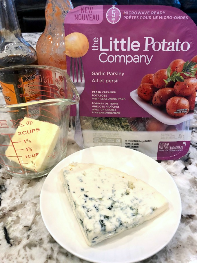 Blue cheese, butter, hot sauce, Worcestershire sauce and a Microwave Ready Package of The Little Potato Company's Creamer potatoes.