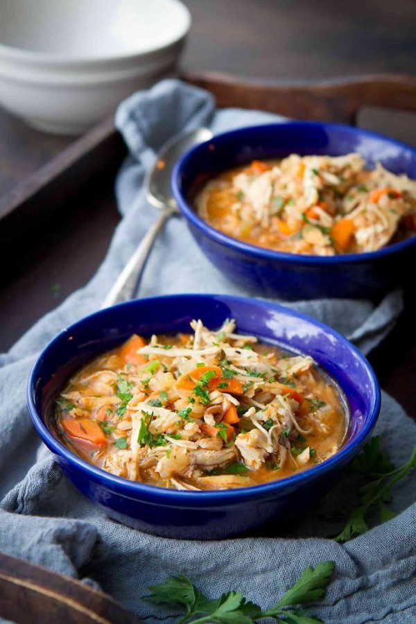 Instant Pot Chicken Stew with Farro in blue bowls