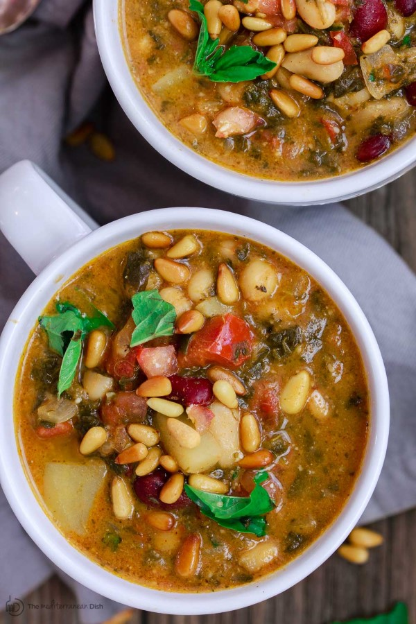 Mediterranean Bean Soup Recipe with Tomato Pesto in white mugs