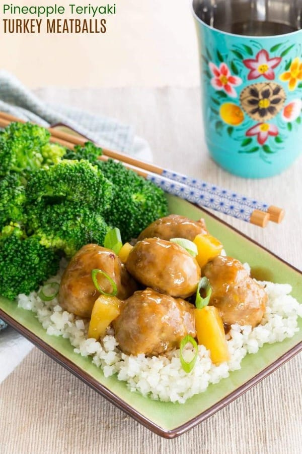 Pineapple Teriyaki Turkey Meatballs on a green plate with chopsticks