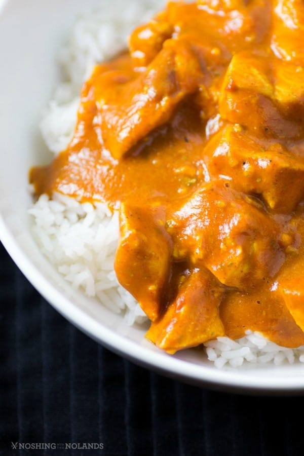 Healthy Slow Cooker Butter Chicken over rice in a white bowl