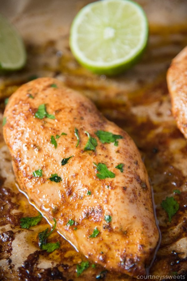 Chili Lime Chicken on a sheet pan with lime