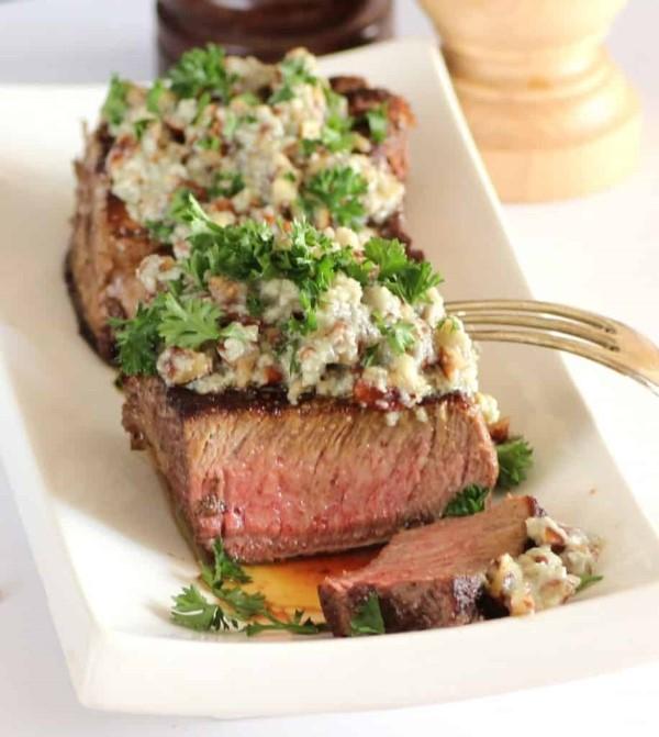 Beef Tenderloin with Stilton Pecan Butter on a plate sliced