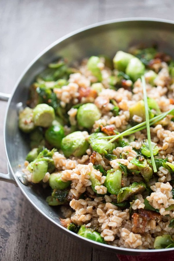 Brussels sprouts and farro salad in a metal serving dish