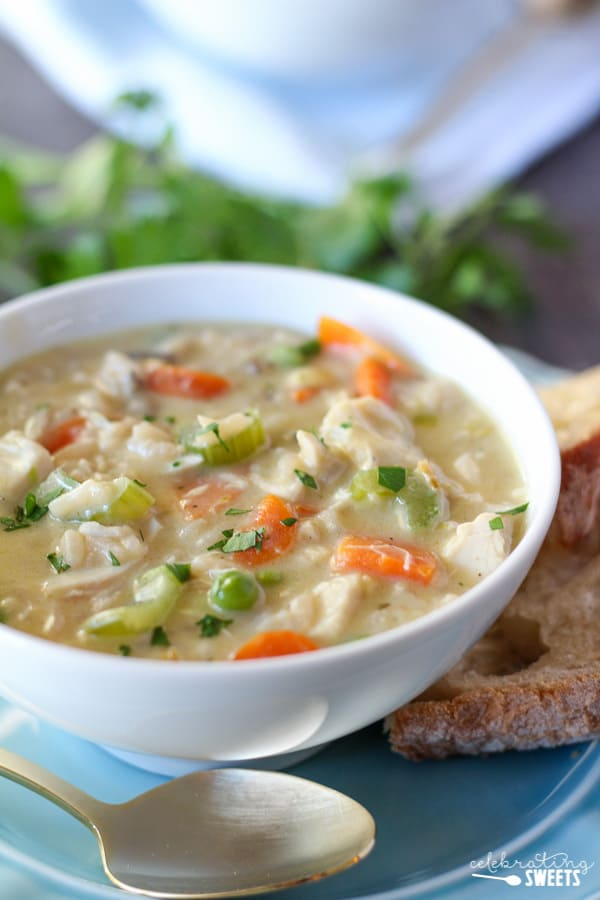 Easy Creamy Chicken Wild Rice Soup in a bowl with a spoon and bread