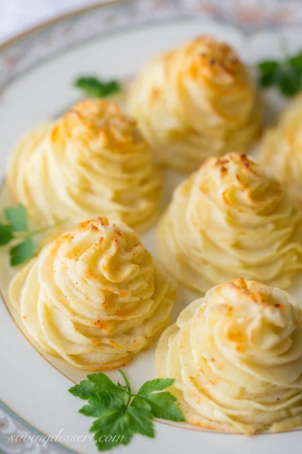 40 Amazing Easter Side Dishes including Duchess Potatoes on a white serving platter