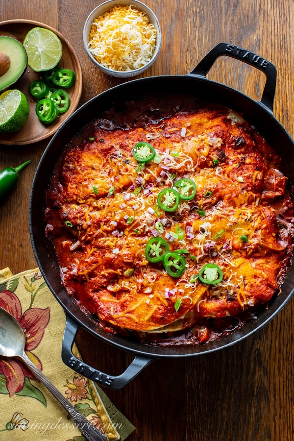 Easy Chicken Enchiladas Recipe in a skillet with jalapeno slices