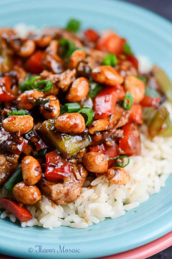 Easy Kung Pao Chicken Recipe over rice on a blue plate