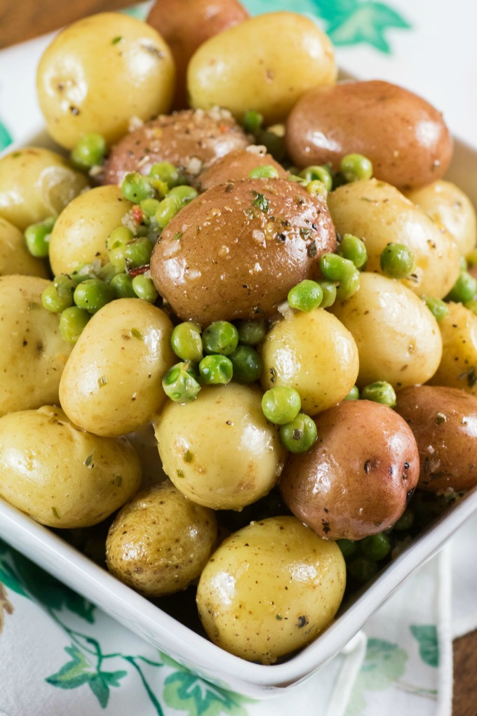 Herb Lemon Butter Peas and Little Potatoes in a white bowl