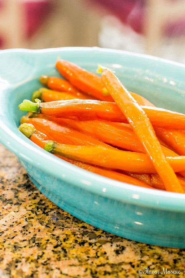 Honey glazed carrots in a blue serving dish