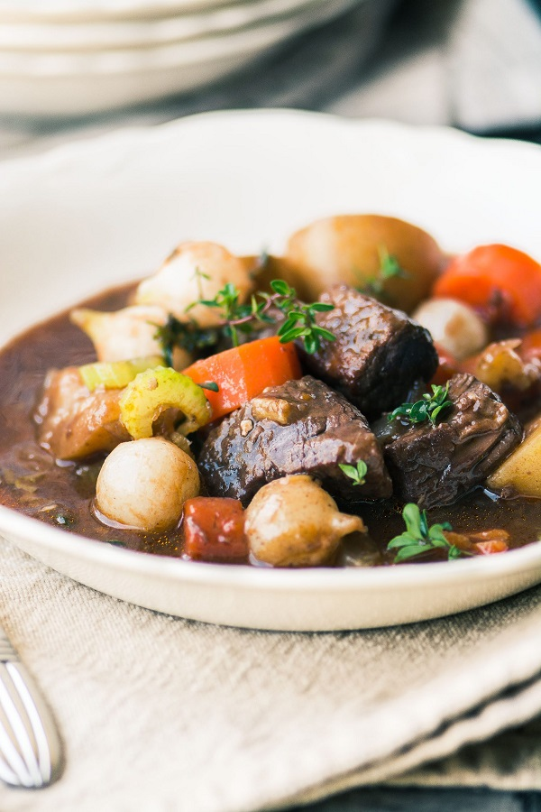 Best Instant Pot Beef Bourguignon in a white bowl