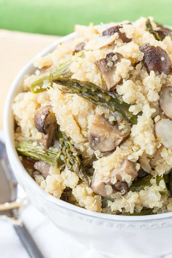 Roasted Asparagus and mushroom quinoa salad in a white serving bowl