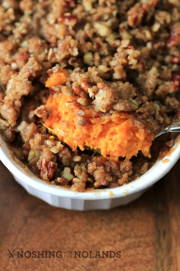Ruth's Chris copy cat sweet potato casserole in a white casserole dish and a serving spoon