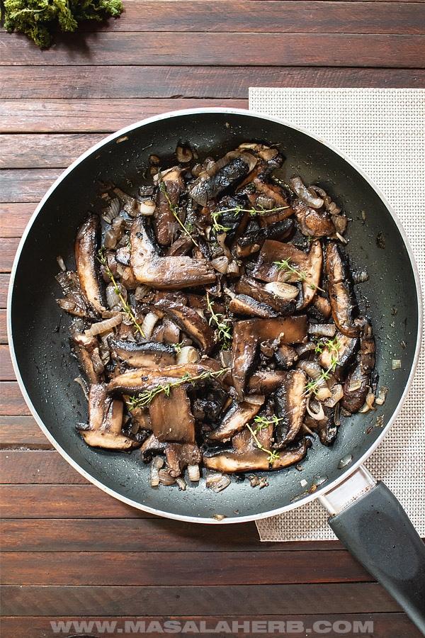 Sauteed portobello mushrooms in a fry pan