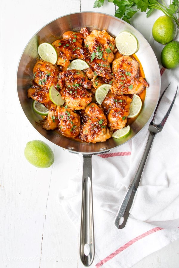 Spicy Honey Lime Chicken Thigh Recipe in a skillet with a white background