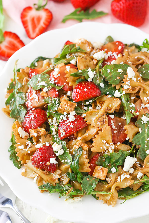 Strawberry Feta balsamic pasta salad in a white serving bowl
