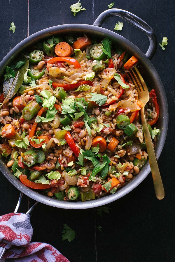 Vegetable Jambalaya in a skillet with a fork