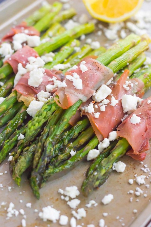 Prosciutto wrapped asparagus with feta in a cooking tray