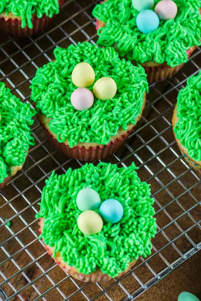 Easter cupcakes on a wire rack.