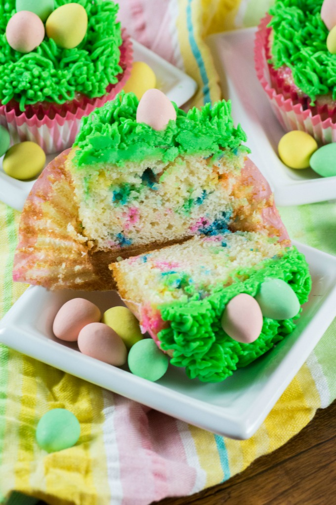 Easter Cupcake cut in half to show sprinkles on the inside.