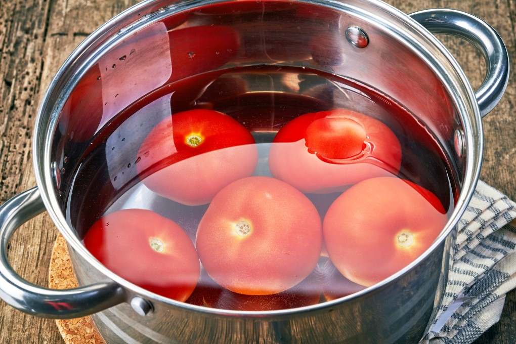 Tomatoes in a pot in water