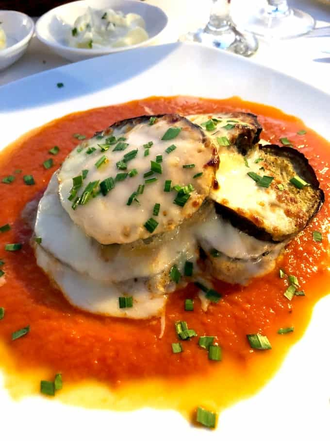Eggplant Parmesan on a white plate