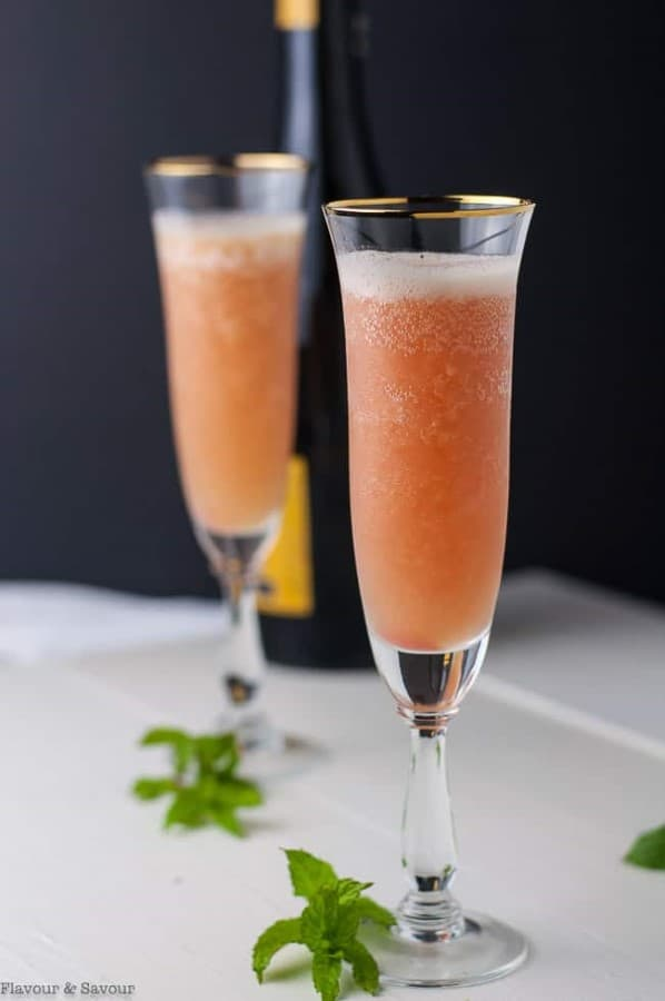 Rhubarb Bellini Prosecco Cocktail in champagne flutes