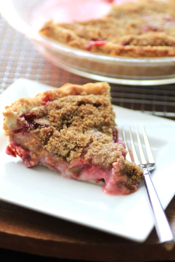 Rhubarb Strawberry Sour Cream Pie served on a white plate from 45 Delectable Rhubarb Recipes