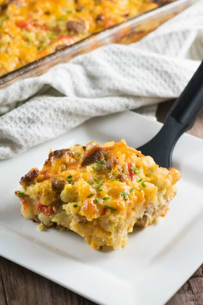 Turkey Sausage Hash Brown Breakfast Casserole being served onto a white plate