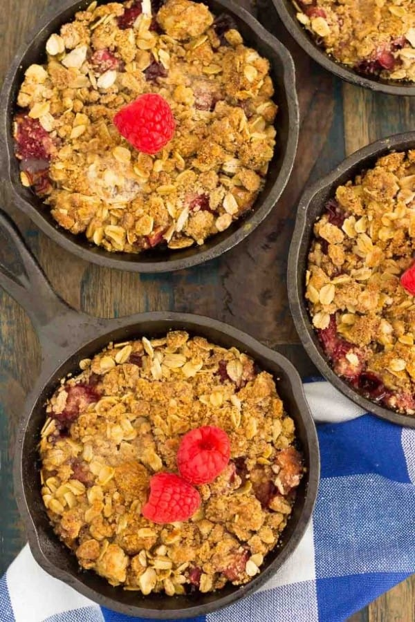 Raspberry Rhubarb Crisp in small cast iron pans from 45 Delectable Rhubarb Recipes