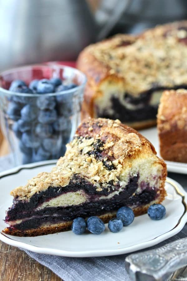 Blueberry Brioche Coffee Cake on a plate with fresh blueberries