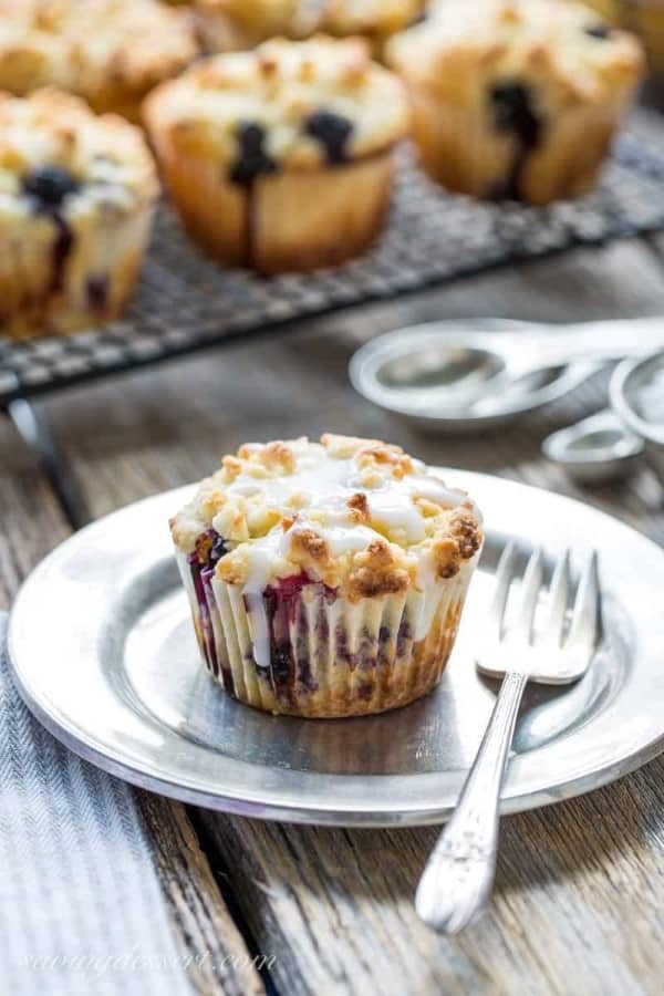 Lemon Blueberry Muffins with Crumble Topping with one on a plate with a fork