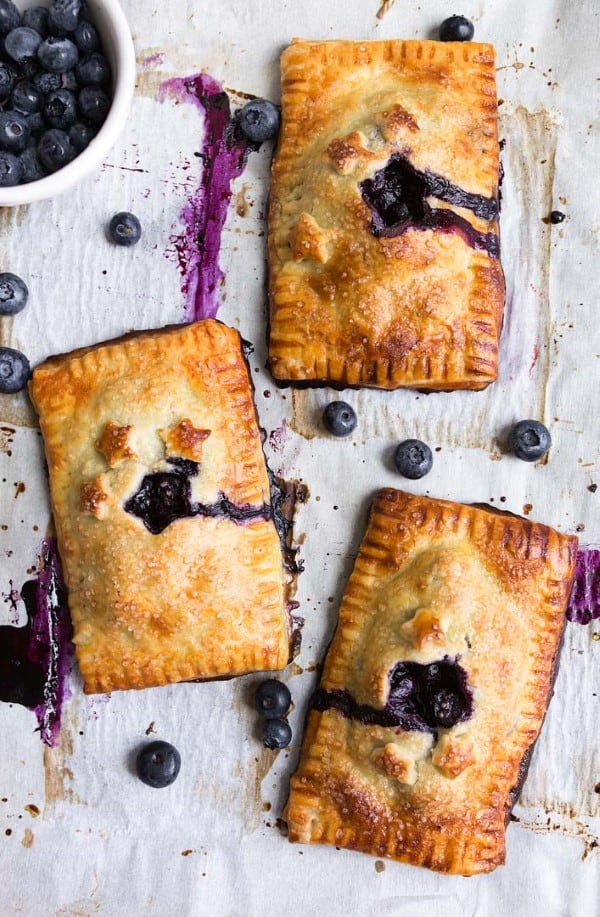Mini Blueberry Hand Pies on a parchment lined cookie sheet