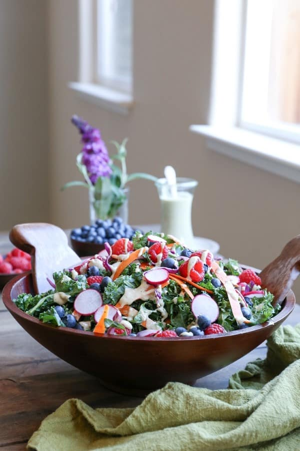 Kale and Blueberry Salad with Vegan Buttermilk Dressing in a wooden bowl on a table