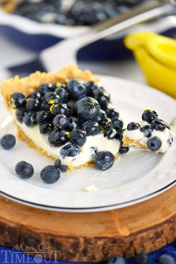 No Bake Blueberry Lemon Cream Pie on a white plate on a round board