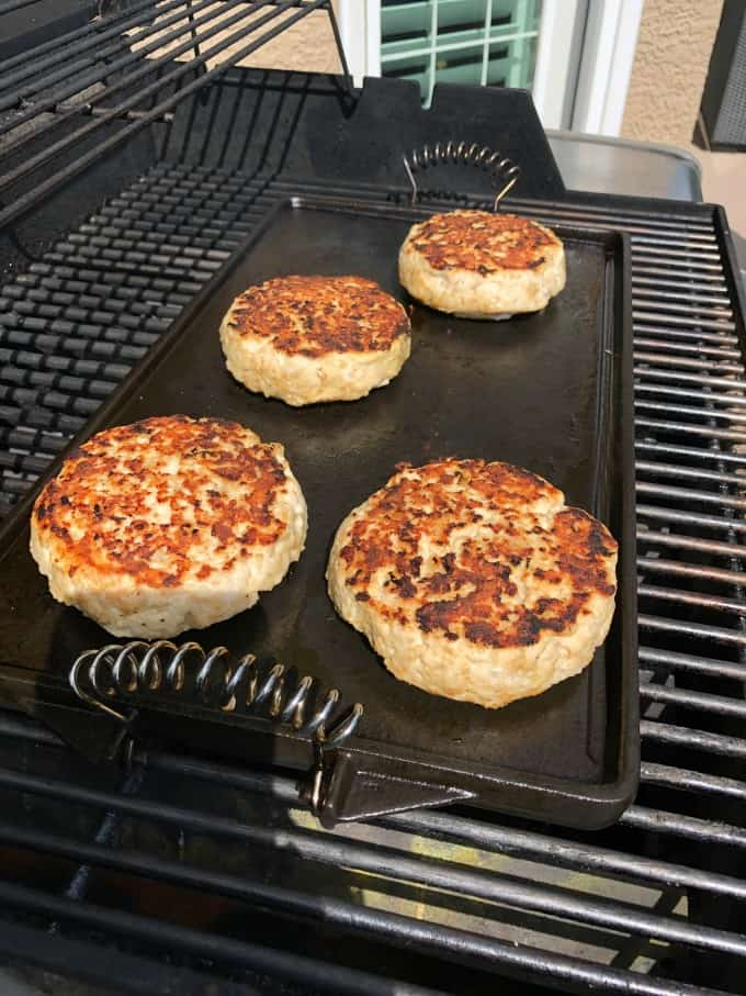 Turkey burgers on a flat top on the grill