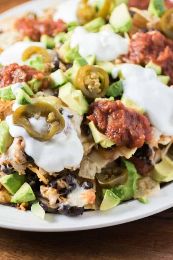 EASY BEAN CHICKEN NACHOS on a white platter