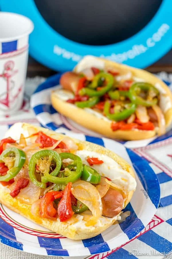 SEATTLE HOT DOGS WITH ROASTED RED PEPPERS on blue and white striped paper plates