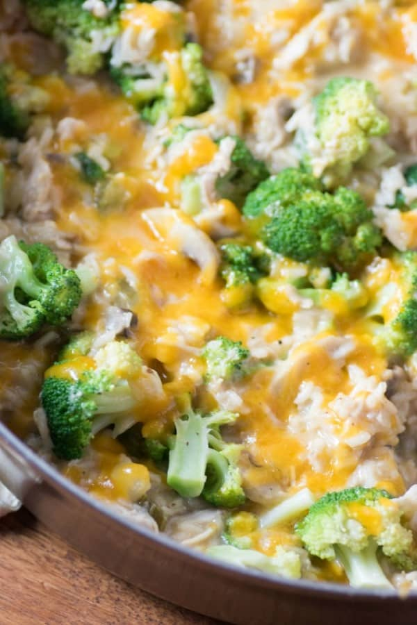 STOVE TOP CHICKEN BROCCOLI CHEESY RICE CASSEROLE in a skillet