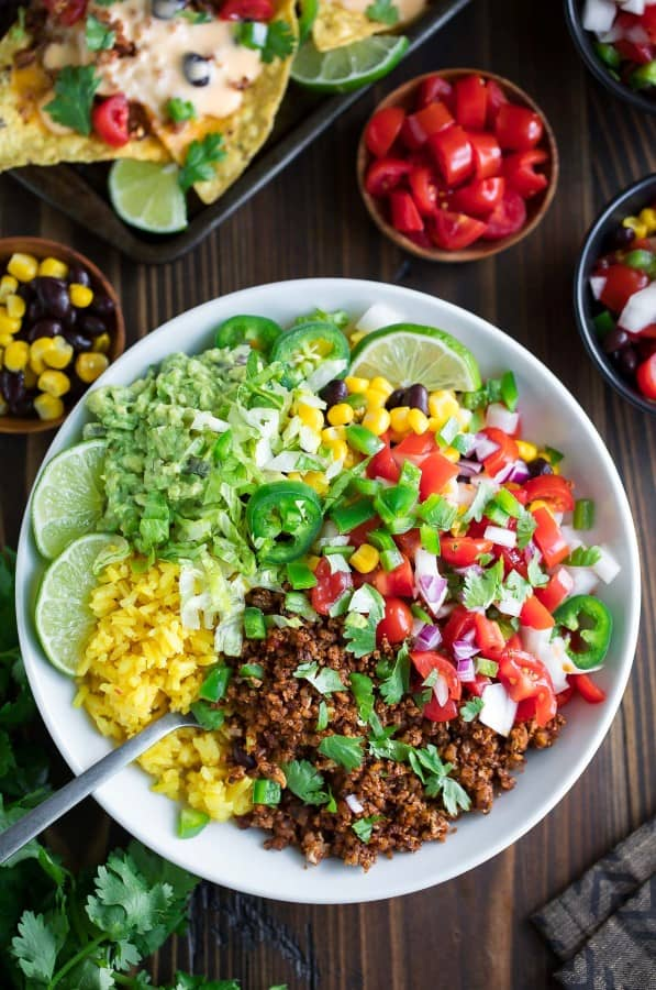 VEGETARIAN TACO BOWLS, colorful and fresh on a wooden board