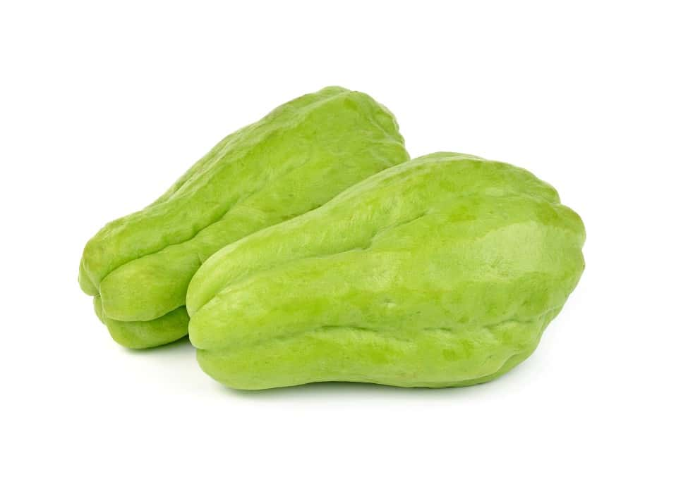 Two Chayote squash on a white background