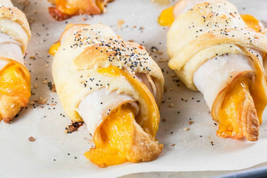 Cheese melting out from a turkey cheddar crescent roll