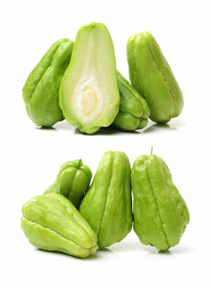 Two pictures of chayote squash, top one with one cup open and bottom on with them standing against each other.
