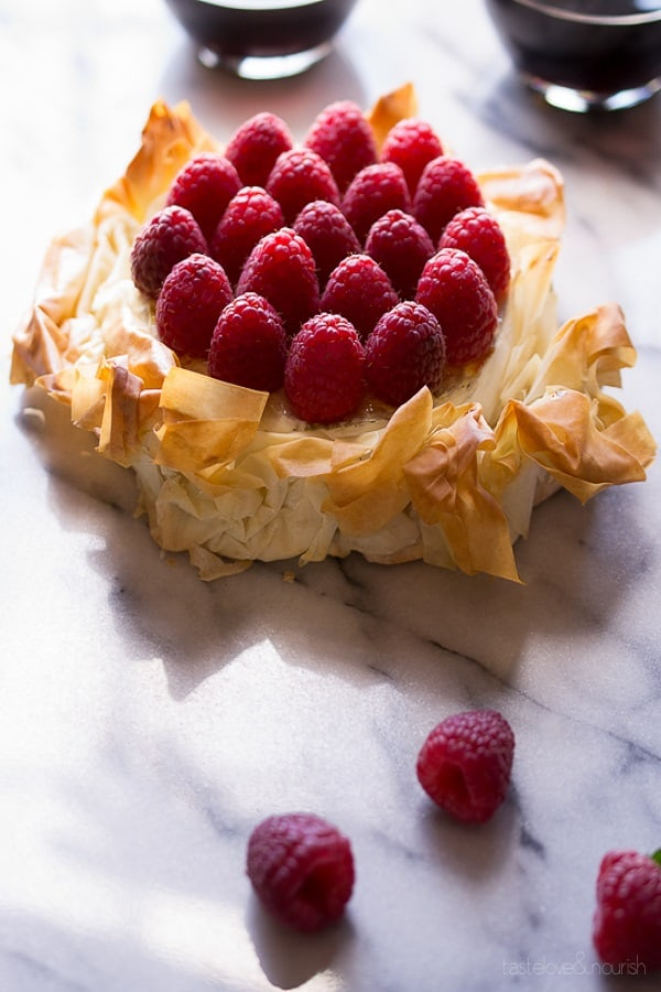 Brie Phyllo Torte With Fresh Raspberries on a marble slab from 18 Easy Hot Party Appetizer Recipes
